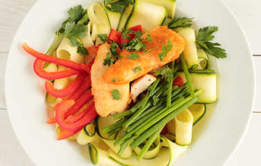 Chicken with zucchini, red paprika and fresh chive