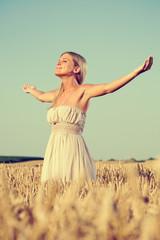 Woman meditating in wheat field
