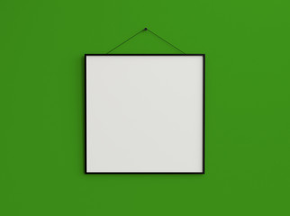 slim square blank photo frame on screw composition on green wall