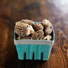 basket of moral mushrooms on wooden table