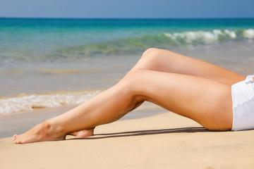 Woman's  legs on the beach