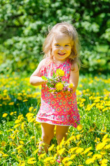 Little girl with bouquet in the park