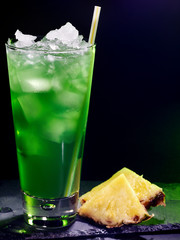 Green pineapple cocktail  on dark background 16.