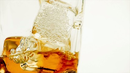 pouring whiskey on white background, whisky relax time concept