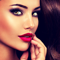 seductive woman with dark brown eye makeup and bright red lips