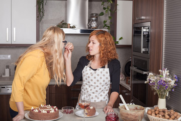 Girlfriends eating and cooking together