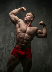 Strong muscular male in studio