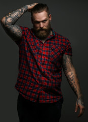 Male with tattoo on arms in studio