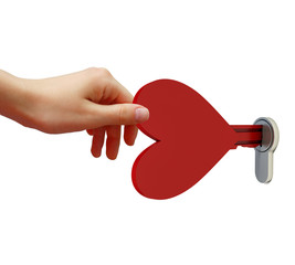 Human hand opens the lock key in the form of heart
