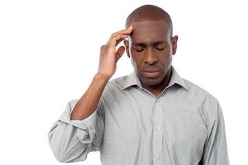 Middle aged man having headache.