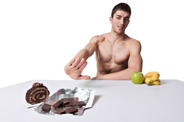 Man with fruits and cake