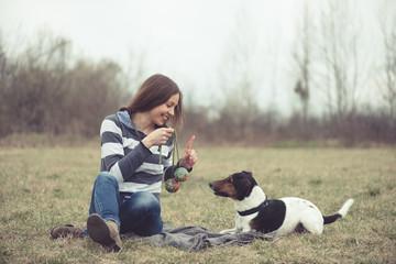 Woman having fun with her dog
