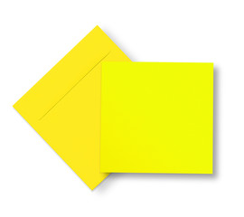 Yellow envelope and card on white
