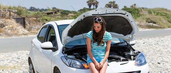 Woman is standing near broken car