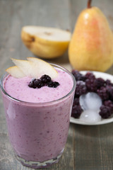 Fruit - berry smoothies with  pear and blackberry  with yogurt .