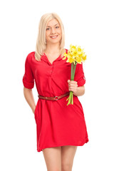 Girl in a red dress holding a bunch of tulips