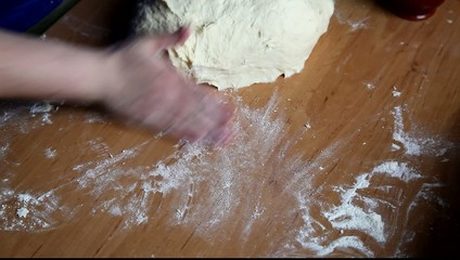 Woman knead dough on the table. HD video