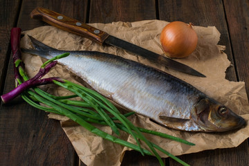 Salted herring, knife and onions