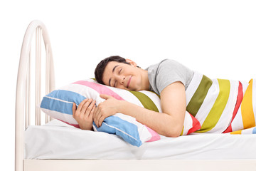 Man sleeping in a bed and dreaming sweet dreams