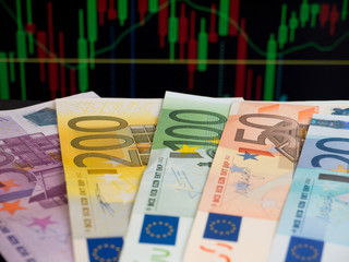 Euro banknotes on the chart background