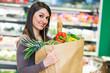 Leinwanddruck Bild - Woman shopping in a supermarket