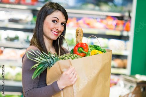 Leinwanddruck Bild Woman shopping in a supermarket