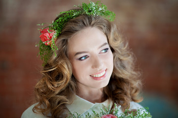 Portrait of a beautiful young girl with a wreath on head