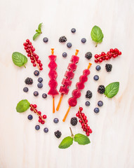 Berries Ice cream pops with summer berries, top view
