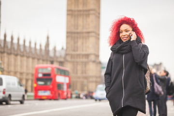 Beautiful woman talking on mobile with Big Ben on background