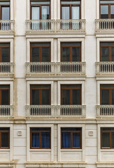 Facade of a building with windows and balconies