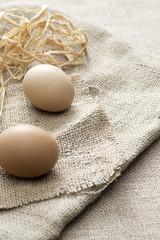 image of organic eggs on jute background