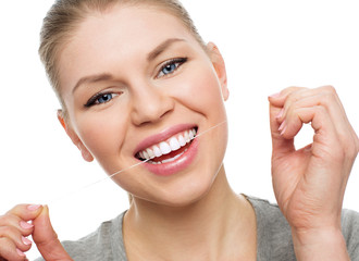 Oral hygiene. Caries prevention. Young girl using dental floss
