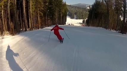 Skier going down the ski run in Bukovel, Ukraine