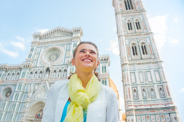 Happy woman looking into distance in front of duomo in florence
