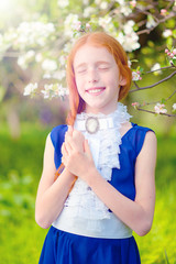 red-haired girl in a sunny garden