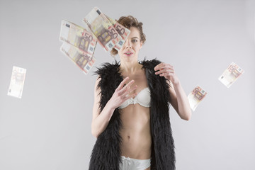 sexy european woman with fur throwing euro money banknote