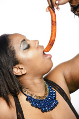 Woman eating spanish sausage called chistorra
