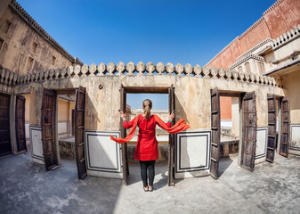 Woman opening door in Rajasthan