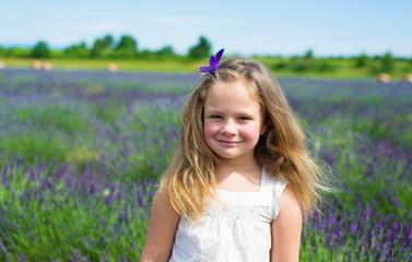 Portrait of a cute  little girl  on a lavender field
