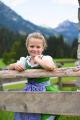 Little girl wearing a traditional Bavarian dress dirndl
