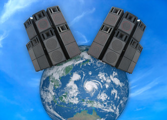 Old powerful stage audio speakers over Earth globe
