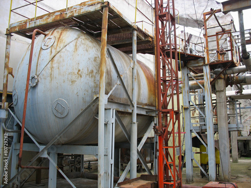 Old rusty industrial chemical tank - 80729262