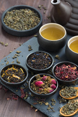 assortment of fragrant dried teas and green tea, top view