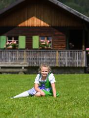 Llittle girl wearing a traditional Bavarian  dress dirndl
