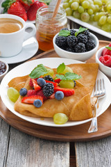 breakfast - crepes with fresh berries and honey, coffee