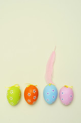 decorated easter eggs in an egg carton