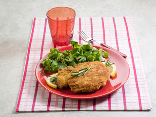 breaded cutlet  with salad