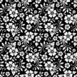 Vintage seamless white floral pattern on a black background.