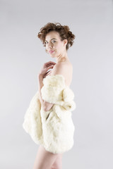 young european  woman with fur posing half naked