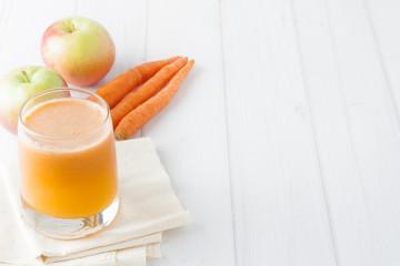 apple carrot juice in  a glass